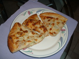 Naan Bread White Pizza Featuring Broccoli Cuts and Prosciutto